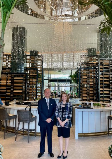 Bret Clesi, Dean of the Consular Corps and Honorary Consul of Albania and the Honorary Consul of Canada Pat Denechaud in front of the Four Seasons Hotel's lobby bar, The Chandelier Bar.